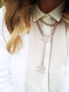 Chanel necklace under collar. Brilliant.