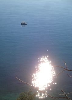 The sun reflected in the water of #Arvanitia Beach in #Nafplio