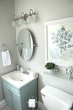 I like the mirror and picture above the shelfSimple, yet beautiful bathroom. House of Turquoise: Bower Power Bathroom Makeover. Color palette softens the effect of slate. Office Bathroom, Bathroom Renos, Bathroom Ideas, Bathroom Small, Bathroom Artwork, Bathroom Colors, Downstairs Bathroom, Bathroom Cabinets, Lowes Bathroom