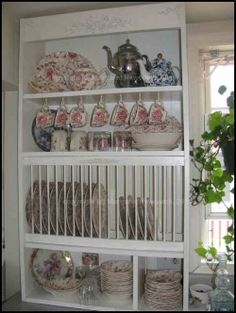 I like this plate rack - with a few changes I could display my Fiestaware to give me more cabinet space and make it user friendly too!  DIY project (for Steve) :)
