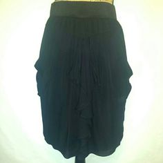 BCBG Black skirt with pockets Gorgeous bcbgmaxazria black sil skirt with front pockets excellent condition worn only once BCBGMaxAzria Skirts