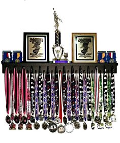 The Premier Award Display Rack for all your hard-earned Award Medals, Trophies, and Plaques!  All our Medal Award Racks are 100% Handmade in America and are made from 100% solid poplar and birch wood. All orders ship within 1-3 business days! All 3Ft Medal Award Racks include: 29 pegs to accommodate lanyard ribbon medals Dual Groove shelf design to accommodate up to 14 pin style cased medals 2 1/2″ wide top shelf to accommodate trophies, plaques or other accolades Product includes 3 screws fo...