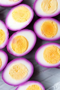 Pink Pickled Eggs | The Worktop --  Red cabbage gives these Pink Pickled Eggs a natural eye-catching dye job. A true showstopper, as the vibrant pink glows against the stark egg white.