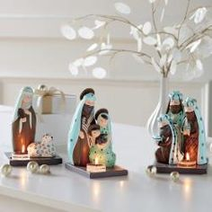 modern nativity tealight holder set with the Holy Family, shephed and Three Kings
