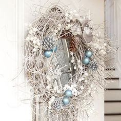Spray-Painted Holiday Wreath - inexpensive can of spray paint, a grapevine wreath, pine cones, twigs and shimmery accents, finish with a ribbon bow - DIY Winter Decor