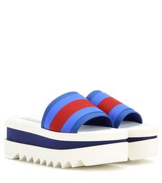 Stella McCartney - Slide platform sandals - The chunky platform not only elevates, it's finished with a saw-edged sole to give this pair added dimension. Play with patterns and print, and clash the blue and red stripes with bold colours. - @ www.mytheresa.com