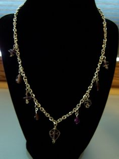 Silver necklace with amethyst charms