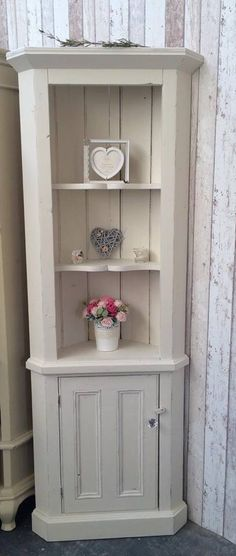 Corner display cabinet transformed in original and duck egg blue inside cupboard