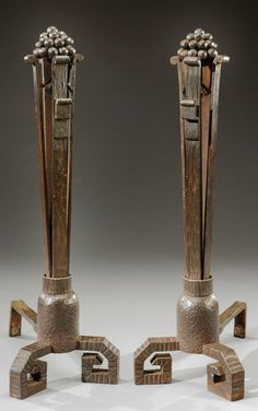 PAUL KISS, attribution, wrought iron andirons, c. 1925, topped with berry clusters. 74 cm H.