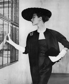 Model in black silk shantung sheath and jacket by Larry Aldrich, photo by Clifford Coffin, Vogue, May 1, 1951