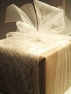 Christmas Gift Wrapping Ideas: Tulle used as ribbon makes this package seem all the more