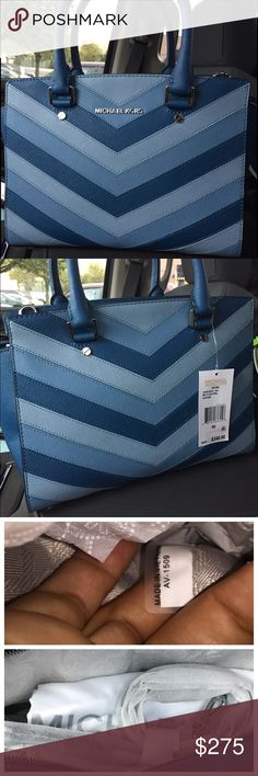"Michael Kors Medium Chevron Selma ⭐️NWT Authentic MK Selma Chevron Satchel in color Sky..⭐️ Features: Patchwork design  Saffiano leather Top zipper closureSilver-tone hardware2 open pockets, zip pocket, cell pocket and key fob insideDouble handles with 4"" handle drop; 19.5"" strap drop ⭐️Medium style satchel⭐️ Adjustable drop strap; 18"" - 20""Zipper closure at topMichael Kors logo on front Key fob insideMeasurements: 15"" x 9"" x 5""Gorg BagNO TRADESLess on Ⓜ️ Michael Kors Bags Satchels"