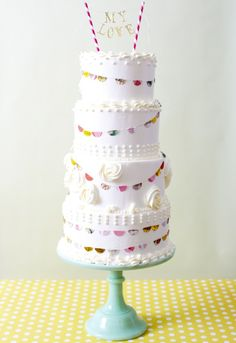 i like the banner and garland around this cake.  fun!