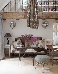 Jill Brinson drapes a cowhide on a white settee/sofa ~ as seen in House Beautiful