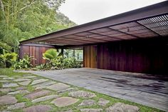 AMB House by Jacobsen Arquitetura situated on the coast of São Paulo, Guaruja City in the middle of the Atlantic Forest.