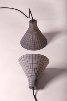 Studio Itai Bar-On's concrete Grid lamps are patterned with wireframe lines