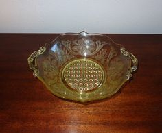 Yellow Depression Glass Serving Bowl -- Floral Pattern by LSFindsVintageGoods on Etsy https://www.etsy.com/listing/235876043/yellow-depression-glass-serving-bowl