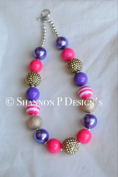 A personal favorite from my Etsy shop https://www.etsy.com/listing/267681474/purple-pink-and-gold-chunky-beaded
