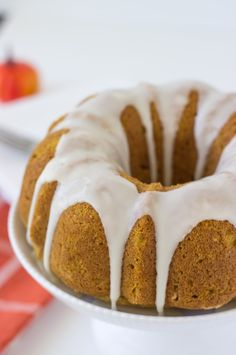 A moist and spiced pumpkin pound cake with hints of orange is topped with a sweet apple cider glaze.