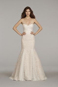 Dress: Hailey Paige Ivory over cashmere lace fit to flare bridal gown with lingerie strap detailing, english net ruched bodice and godets in skirt, bow at natural waist and chapel train.