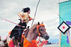 Almost a bulls-eye. © Glenn Waters. Japan. The archer rides at full gallop and must try and shoot a small target about 6 meters away