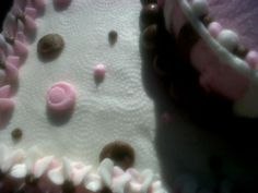 Close up of cake texture--after the white icing dried, I used a paper towel to rub the concentric circular pattern.  After that, I topped it with more polka dots.  FUN cake!