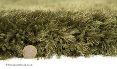 Pearl Green Rug (texture close up), a hand-tufted polyester shaggy rug with super dense deep pile made of thick and thin yarns with an incredible 7cm pile height (available in 5 sizes) http://www.therugswarehouse.co.uk/shaggy-rugs/pearl-rugs/pearl-green-rug.html #rugs