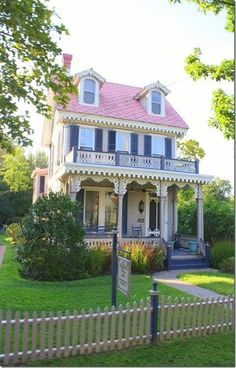 Victorian cottage with Queen Anne gingerbread details, upstairs front-facing porch, with cuteness goes on forever.