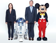From left, Lucasfilm President Kathleen Kennedy, R2-D2, Disney Chairman and CEO Robert Iger, and Mickey Mouse