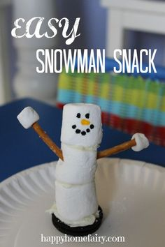 easy snowman snack at happyhomefairy.com - too cute! fun to do with the kids!
