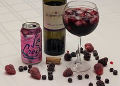 RED WINE SUMMER SPRITZER [Ingredients] • ice • frozen berries (mixed berry, blueberry, or raspberry) • 1 part red wine (1/4 cup) • 3 parts LaCroix Sparkling Water in Berry (3/4 cup) [Directions] Place ice and frozen berries into the glass, top with wine then sparkling water. Kick back and enjoy!