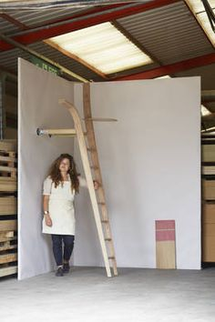 Xenia Mosely designed and made a Ladder That Likes The Wall for Richard & Ab Rogers during The Wish List for LDF 2014. She used American red oak.