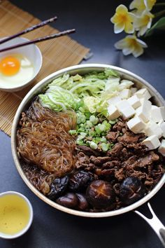 Sukiyaki  With Shirataki noodles this dish is a lot lower in calories.  I've used stevia in place of sugar and it's just fine.  I like a 6 minute boiled soft egg in place of the raw egg dip.  Not into the whites texture when raw.