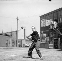 Woman munitions worker plays a game of baseball at the John Inglis Co. Bren gun plant, Toronto, Ontario, May 10, 1941.