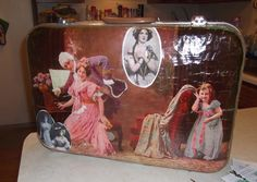 vintage  picture  saved  by decoupage   on an old   suitcase