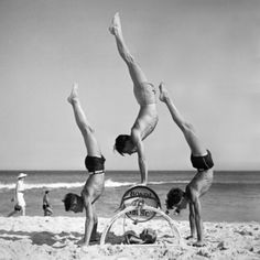 using the surf reel. Bondi resident George Caddy was best known for his success as a jitterbug dancer, but some of his beach acrobatics photos rival those of the better known Max Dupain. Beach Photos, Old Photos, Vintage Photos, Dance Marathon, Surfer Dude, Oral History, Vintage Swimsuits, Bondi Beach, Yoga For Men