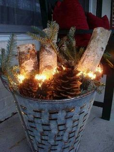 Cute for front porch - tin bucket and fill with greens, pinecones, birch and lights