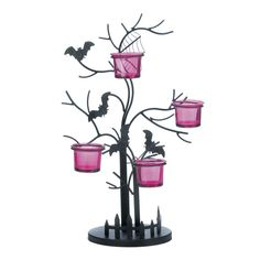 Create the spookiest spot in your home with this candle holder that features four glass candle cups perched in a black iron tree, complete with fence, cobwebs, and bats in flight. Great for Halloween! #candleholder #freeshipping