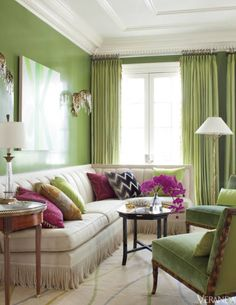 Lime appears on the walls, curtains, art, chairs, and throw pillows