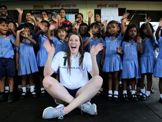 Laureus Ambassador and Olympic gold medalist Missy Franklin poses a picture with children at Foundation of Goodness during the Missy Franklin Sri Lanka Project Visit in Seenegama, Sri Lanka.   Buddhika Weerasinghe, Getty Images for Laureus