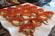 Tomato, bocconcini drizzled with balsamic on bruschetta. One of his summer time h'orderves.