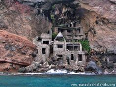 Moonhole, Bequia, Grenadine Islands, Caribbean. Dwellings build in the 1960s but abandoned due to rockfalls (duh!)