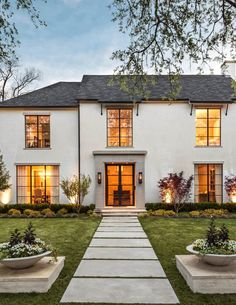 Beige stucco exterior exterior transitional with gas lanterns double glass doors