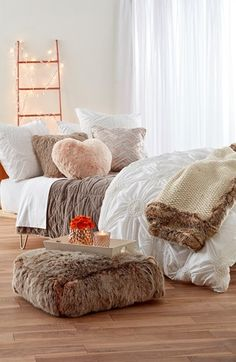 Immaculate quilting and plush faux fur make this bedroom set extra cozy and cute.