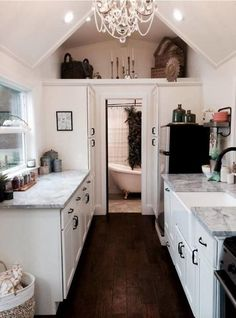 vintage-glam-tiny-heirloom-9 I really like the fresh look of mostly white or a lite palette and then the floors of what ever design flavor. The space seems so much larger...