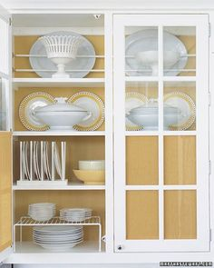 Don't feel limited by the existing storage you have in your kitchen. Take, for example, the cabinet where you store dishes and serving pieces. You can add capacity to that space by looking for ways to use it efficiently. In fact, it can be as easy as installing store-bought plate and bowl racks.