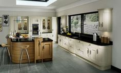 Iona Inframe in Light Oak  and Painted White Cotton a Kitchen Stori collection Kitchen available from Kitchens Direct NI