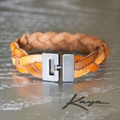 Womens Braided Leather Bracelet/Cuff (Saddle Tan or Maroon)  This stylish womens braided bracelet with brushed metal clasp is made with real leather, stained, weather-coated and braided. Brushed metal clasp is stylish and holds tightly and securely. IMPORTANT *** IMPORTANT *** IMPORTANT *** IMPORTANT PLEASE READ: Measure your wrist size EXACTLY and select the CLOSEST to the size of your wrist in the drop-down menu. We will adjust the cuff size accordingly. DO NOT select a size larger than…