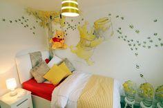 Cute Winnie the Pooh wall art and detailing, calming colour scheme.
