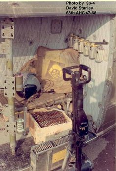 Gunner hole in a Huey helicopter and Alfred E. Newman. ~ Vietnam War